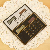 eY24-Solar Slim Card General Purpose Calculator